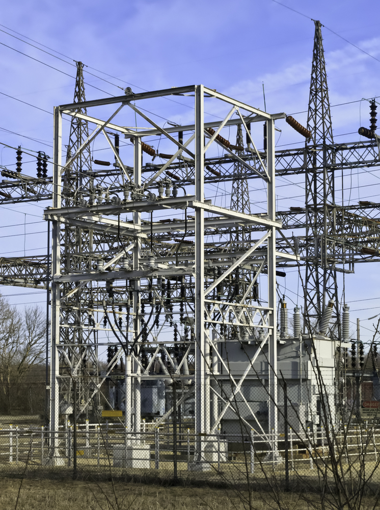 Part of electrical substation with steel lattice structures